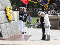 The Emperor and Empress offer flowers and bow at the foot of Rizal Monument commemorating Filipino nationalist Jose Rizal in Manila on Jan. 27, 2016. (Pool photo)