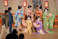 A group of apprentice geisha poses for a photograph as they are clad in attire for the upcoming