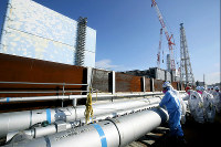 Pipes to be used in the creation of an impermeable wall of frozen soil are seen aboveground on the mountain side of the Fukushima No. 1 Nuclear Plant surrounding reactor buildings number 2, 3 and 4, from the far back left side, on Feb. 23, 2016. (Mainichi)