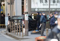 The car believed to have hit several pedestrians is seen on a sidewalk near Osaka Station in Osaka's Kita Ward on Feb. 25, 2016. (Mainichi)