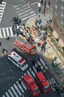 In this photo taken from a Mainichi Shimbun helicopter, ambulances and fire trucks are seen at an intersection near Osaka Station in Osaka's Kita Ward where a car accident involving multiple pedestrians occurred on Feb. 25, 2016. (Mainichi)