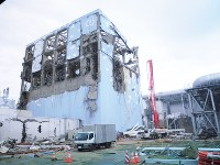 The No. 4 reactor building at the Fukushima No. 1 Nuclear Power Plant is seen in this May 1, 2011, file photo. The reactor building was badly damaged by a hydrogen explosion. (Photo courtesy of Fukushima Prefectural Police)