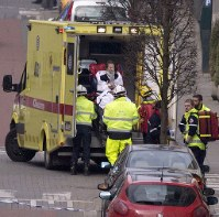 A woman is evacuated in an ambulance by emergency services after a explosion in a main metro station in Brussels on Tuesday, March 22, 2016. (AP Photo/Virginia Mayo)