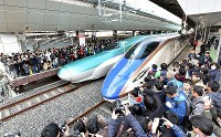 The first train on the newly-opened Hokkaido Shinkansen Line,