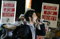 Aki Okuda from the Students Emergency Action for Liberal Democracy-s (SEALDs) organization is seen in front of the National Diet Building in Tokyo's Kasumigaseki district raising his voice against security legislation on March 29, 2016, the day it came into force. (Mainichi)