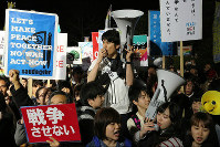 Participants are seen protesting in a demonstration against security legislation held in front of the National Diet Building in Tokyo's Kasumigaseki district on March 29, 2016, the day it came into force. (Mainichi)