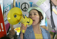 A participant in a demonstration against security legislation is seen raising her voice in front of the National Diet Building in Tokyo's Kasumigaseki district on March 29, 2016, the day it came into force. (Mainichi)