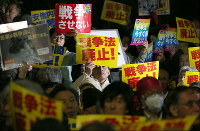 Participants in a demonstration against security legislation are seen protesting in front of the National Diet Building in Tokyo's Kasumigaseki district on March 29, 2016, the day it came into force. (Mainichi)
