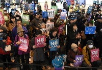 People are seen in the city of Osaka's Kita Ward protesting against security-related legislation after it went into force on March 29, 2016. (Mainichi)