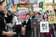 Participants are seen protesting the enforcement of security-related legislation in a demonstration held in the city of Nagasaki on March 29, 2016. (Mainichi)