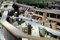 Trains built to one-eightieth scale run on a model railroad at the Kyoto Railway Museum in Kyoto's Shimogyo Ward on April 1, 2016. (Mainichi)