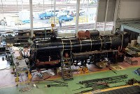 The dismantling of a steam locomotive is seen at the Kyoto Railway Museum in Kyoto's Shimogyo Ward on April 1, 2016. (Mainichi)