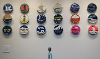 A corner of the Kyoto Railway Museum displays the logos of successive trains at the museum in Kyoto's Shimogyo Ward on April 1, 2016. (Mainichi)
