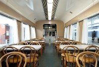 A dining car of a blue train -- dubbed a