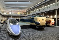 A 500 series Shinkansen, left, and other trains representative of West Japan Railway Co. are seen on the first floor of the main building of the Kyoto Railway Museum in Kyoto's Shimogyo Ward, on April 1, 2016. (Mainichi)