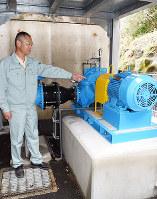 河川を維持するための水を利用して発電する小水力発電に使われる発電機=兵庫県洲本市鮎屋で、登口修撮影