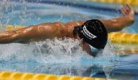 男子100メートルバタフライ決勝、優勝した藤井拓郎=東京辰巳国際水泳場で2016年4月10日、三浦博之撮影