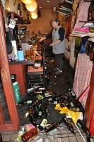 Bottles and other objects are seen scattered inside a Japanese-style pub after a powerful earthquake in Kumamoto's Chuo Ward on April 14, 2016. (Mainichi)