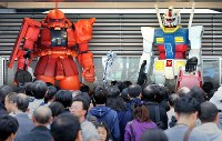 Models of the Gundam and Zaku robots from the anime