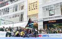 Wheelchair tennis player Yui Kamiji demonstrates the sport at an event to experience Paralympic sports, in Ginza, Tokyo, on May 2, 2016. (Mainichi)