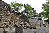 A collapsed section of stone wall at the