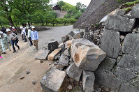 A collapsed section of wall is seen at the western entrance to the