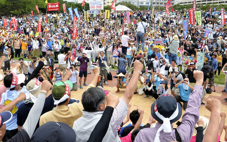Participants in the Peace Action 2016 event in Naha's Shintoshin Park chant