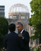 U.S. President Barack Obama places a hand on Japanese Prime Minister Shinzo Abe's shoulder at Hiroshima Peace Memorial Park, on May 27, 2016. Seen in the rear is the Atomic Bomb Dome. (Pool photo)