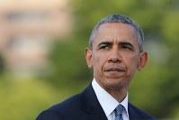 平和記念公園で所感を述べるオバマ米大統領=広島市中区で2016年5月27日午後5時58分(代表撮影)