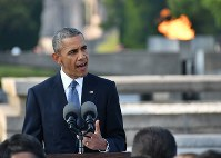 U.S. President Barack Obama gives a speech at Hiroshima Peace Memorial Park on May 27, 2016. The Flame of Peace is visible in the background. (Pool photo)