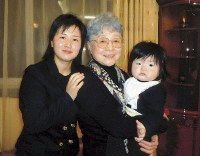 Sakie Yokota holds the daughter of her granddaughter Kim Eun Gyong, left, in Ulaanbaatar in March, 2014. (Photo courtesy of Yoshifu Arita)