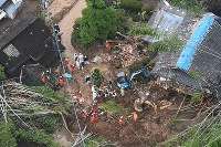 Rescuers work at the site of a landslide, in Kita Ward, Kumamoto, on June 21, 2016. (Mainichi)
