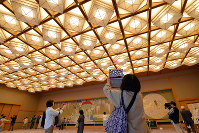 A visitor takes a photo of the ceiling in the Kyoto State Guest House's