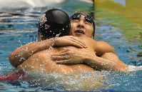 Daiya Seto, back, celebrates with Masato Sakai after winning the 200-meter butterfly final at the Japan championship on April 8, 2016, clinching the Rio Olympics berth. (Mainichi)