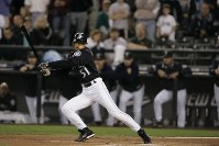 Ichiro Suzuki of the Seattle Mariners achieves a single-season hit record after hitting a single to left field during the first inning of a game against the Texas Rangers at Safeco Field in Seattle on Oct. 1, 2004. (Mainichi)