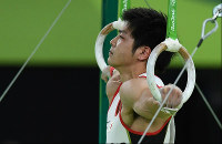 Koji Yamamuro performs on the rings at the Rio Olympics at the Rio Olympic Arena in Rio de Janeiro on Aug. 8, 2016. (Mainichi)
