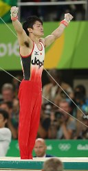 Gymnast Kohei Uchimura appears flooded with emotion as he makes a successful landing from the parallel bars, his final event in the Rio Olympics, on Aug. 10. 2016. (Mainichi Photo/Masahiro Ogawa)