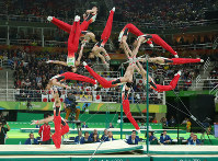 Kohei Uchimura is shown here on the high bar in a composite of 13 consecutive photos taken at the Olympic Arena in Rio de Janeiro on Aug. 10, 2016. (Mainichi Photo/Masahiro Ogawa)