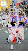 People perform the traditional Awa Dance to the rhythm of the flute and bells in the city of Tokushima, on Aug. 12, 2016.
