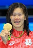 競泳の女子200メートル平泳ぎで金メダルを獲得した金藤理絵=2016年8月11日、梅村直承撮影