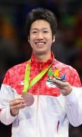 卓球の男子シングルスで銅メダルを獲得した水谷隼=2016年8月11日、小川昌宏撮影