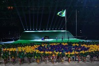 The Brazilian flag is raised as the national anthem is played during the opening ceremony of the 2016 Paralympics at Maracana Stadium in Rio de Janeiro on Sept. 7, 2016. (Mainichi)