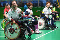 Takayuki Hirose, left, rejoices after hitting the jack in the team semifinals of Boccia at the Rio Paralympics, at Carioca Arena in Rio de Janeiro on Sept. 11, 2016. (Mainichi)
