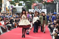 Actress Mariya Nishiuchi, front, and other models appear during the finale of an event at Japan Fashion Week in Tokyo, in Shibuya Ward, on Oct. 23, 2016. (Mainichi)