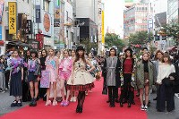 Actress Mariya Nishiuchi, center, and other models appear during the finale of an event at Japan Fashion Week in Tokyo, in Shibuya Ward, Tokyo, on Oct. 23, 2016. (Mainichi)