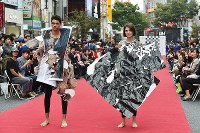 Models pose on a street runway during Japan Fashion Week in Tokyo, in Shibuya Ward, on Oct. 23, 2016. (Mainichi)