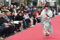 A model walks along a street runway during Japan Fashion Week in Tokyo, in Shibuya Ward, on Oct. 23, 2016. (Mainichi)