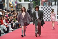 Models walk along a street runway during Japan Fashion Week in Tokyo, in Shibuya Ward, on Oct. 23, 2016. (Mainichi)