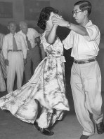 Prince Mikasa is seen dancing at a square dance party sometime around 1950. (Mainichi)