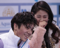 Shoma Uno, of Japan, and his coach Mihoko Higuchi react to his marks after skating his short program at the Rostelekom Cup ISU Grand Prix of figure skating event, in Moscow, Russia, on Friday, Nov. 4, 2016. (AP Photo/Ivan Sekretarev)